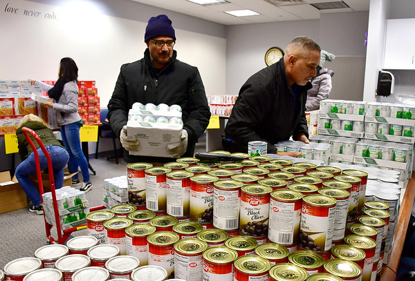 11/15/2018 Mike Orazzi   Staff Bristol Hospital's Lou Therrien and Miguel Santos while unloading food for the WIC program at Bristol Hospital provides Thanksgiving meals for 180 low-income families.