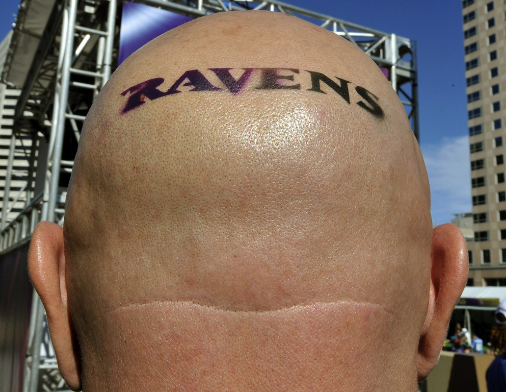 . A Baltimore Ravens fan poses before the start of Super Bowl XLVII between the San Francisco 49ers and the Baltimore Ravens on February 3, 2013 at the Mercedes-Benz Superdome in New Orleans.    TIMOTHY A. CLARY/AFP/Getty Images