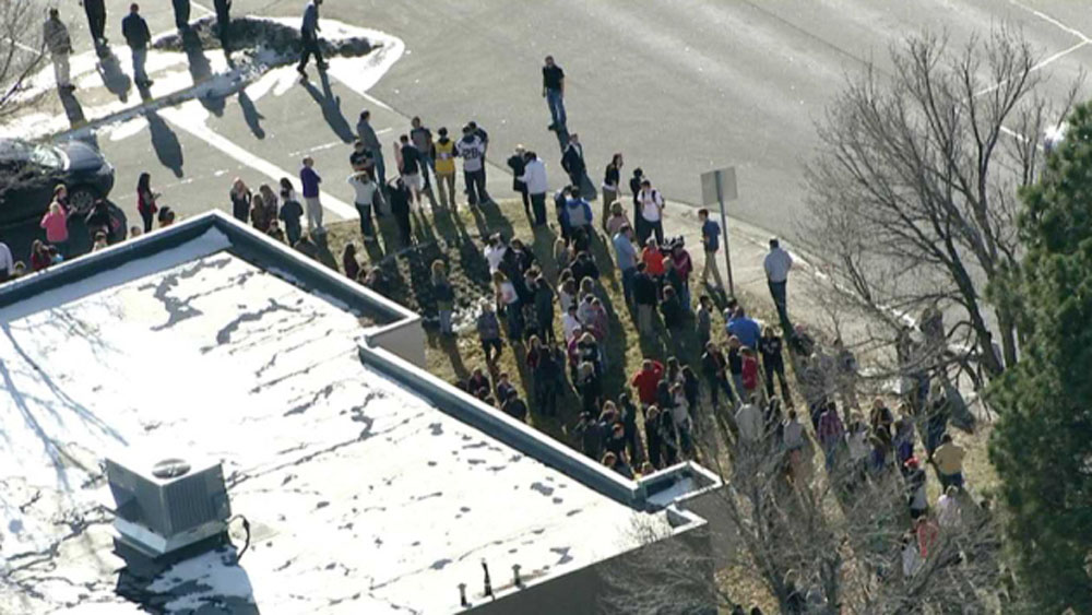. In this still image taken from video provided by Fox 31 Denver,  students gather just outside of Arapahoe High School as police respond to reports of a shooting at Arapahoe High School in Centennial, Colo. Friday, Dec. 13, 2013. Colorado division of emergency management spokeswoman Micki Trost said her director went to the school and their weren\'t any more immediate details. (AP Photo/KDVR)