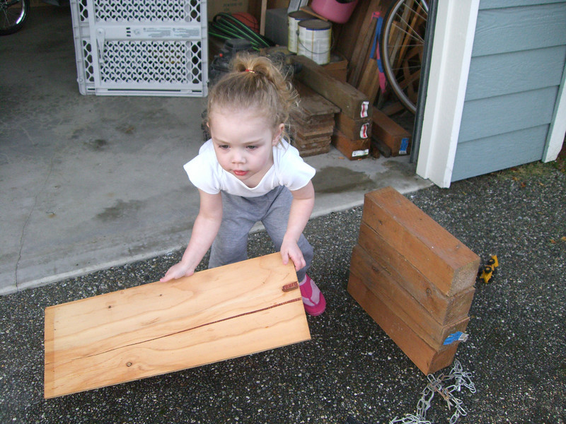 Building a ramp for her Hot Wheels to roll down!