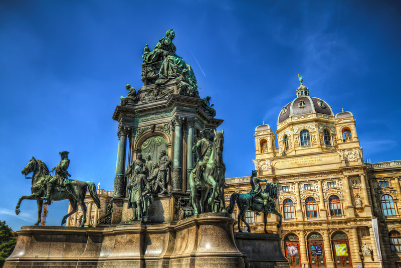 Statue on the Maria-Theresien-Platz  One from Vienna today. These old statues look so great in hdr. All the detail just shows in the photo. This was taken on a very hot, very sunny day, which is quite visible on the photo. The sky was really this blue :)  HDR from three shots, taken with Canon 7D with Sigma 10-20mm lens, handheld