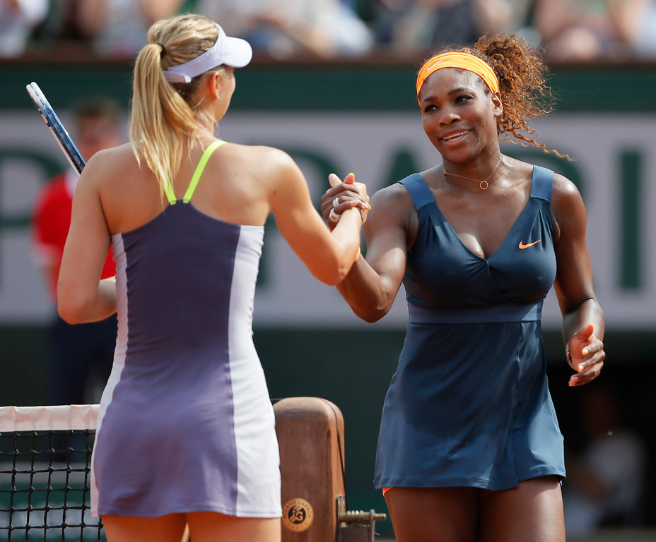 . Serena Williams of the U.S., right, shakes hands with Russia\'s Maria Sharapova, left, after defeating Sharapova in two sets 6-4, 6-4, in the women\'s final of the French Open tennis tournament, at Roland Garros stadium in Paris, Saturday June 8, 2013. (AP Photo/Michel Spingler)