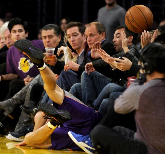 . Suns Steve Nash ends up flying into Woody Harrelson who sat court side in the second half. The Lakers defeated Phoenix Suns 99-83 in a game played at Staples Center in Los Angeles,  CA 1/10/2012 (John McCoy/Staff Photographer)