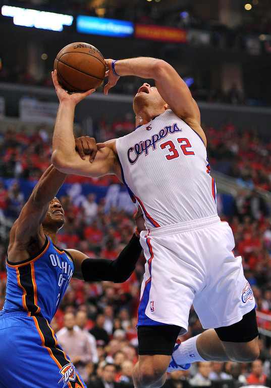 . The Thunder\'s Russell Westbrook pulls the Clippers\' Blake Griffin to the floor during a layup, Friday, May 9, 2014, at Staples Center. (Photo by Michael Owen Baker/Los Angeles Daily News)