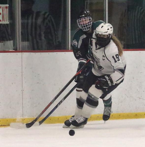 Billerica/Chelmsford vs HPNA (Haverhill Pentucket & North Andover) girls hockey. Billerica/Chelmsford's Sarah Caruso (14) and HPNA's Katerina Yelsits (19). (SUN/Julia Malakie)