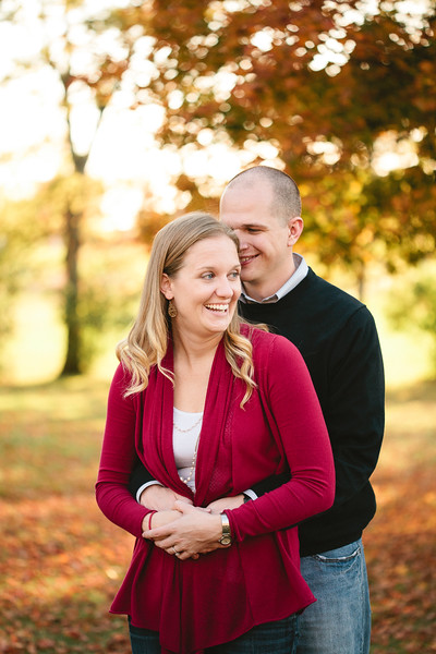 engaged couple laughing in fall