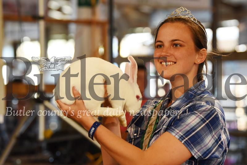 Harold Aughton/Butler Eagle: Sarah Brandon, 16, of Prospect displays her rabbit, Loin, during the 42 Annual Junior Livestock Market Sale at the Butler Farm Show.