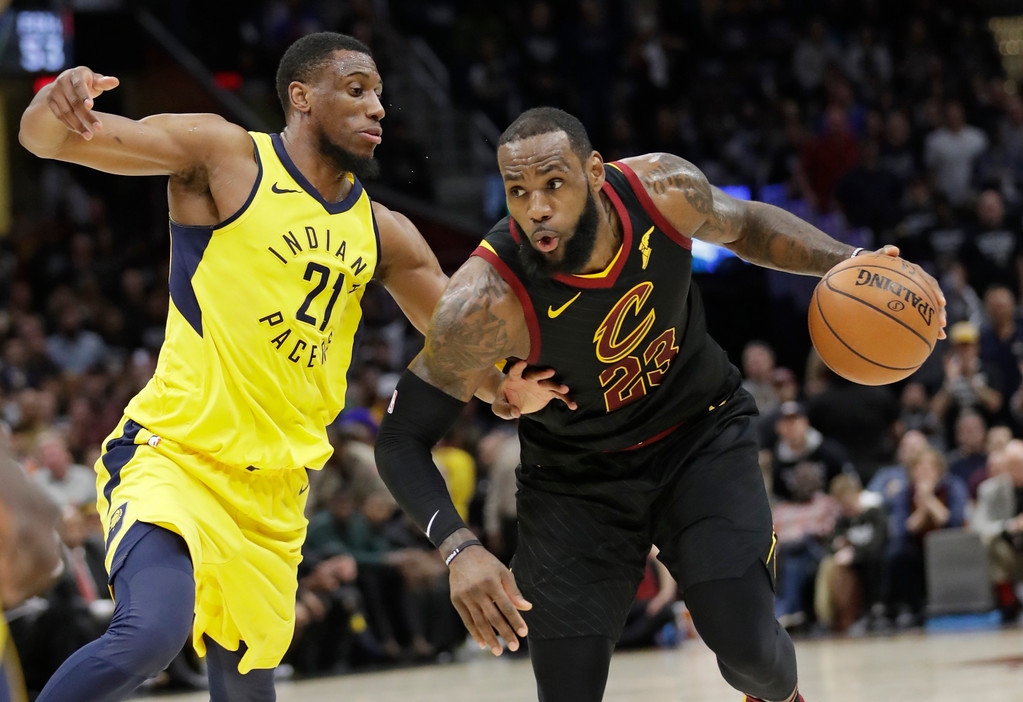 . Cleveland Cavaliers\' LeBron James (23) drives against Indiana Pacers\' Thaddeus Young (21) in the first half of Game 7 of an NBA basketball first-round playoff series, Sunday, April 29, 2018, in Cleveland. (AP Photo/Tony Dejak)