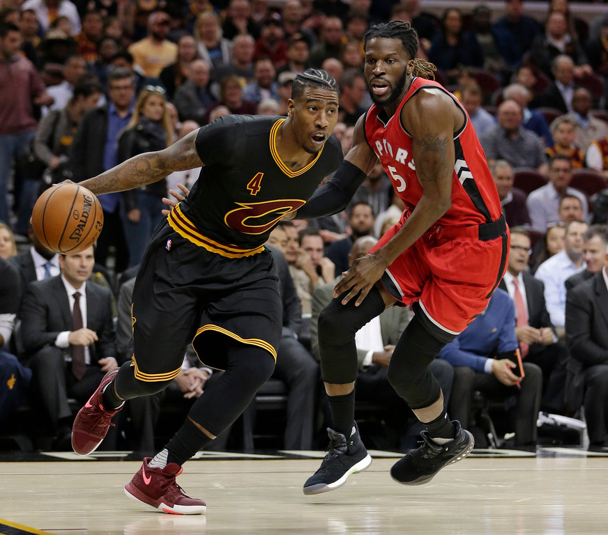 . Cleveland Cavaliers\' Iman Shumpert (4) drives past Toronto Raptors\' DeMarre Carroll (5) in the first half of an NBA basketball game, Wednesday, April 12, 2017, in Cleveland. (AP Photo/Tony Dejak)