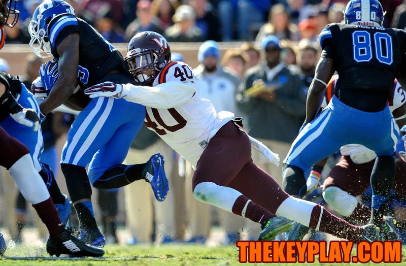 Virginia Tech linebacker Deon Clarke (40) wraps up and tackles Duke running back Shaun Wilson (29). (Michael Shroyer/ Thekeyplay.com)