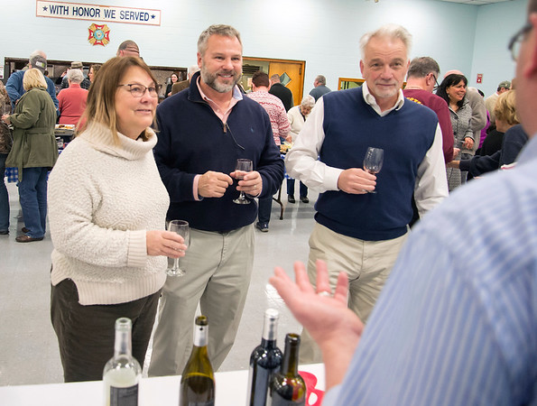 02/27/20 Wesley Bunnell | StaffrrA wine tasting was held on Thursday night with proceeds benefiting Wreaths Across America was held at the New Britain VFW Post. Penny Hill, L, and Pierre Hill, R, join a friend sampling wine at the Allan S. Goodman table which was staffed by Michael Greenberg.
