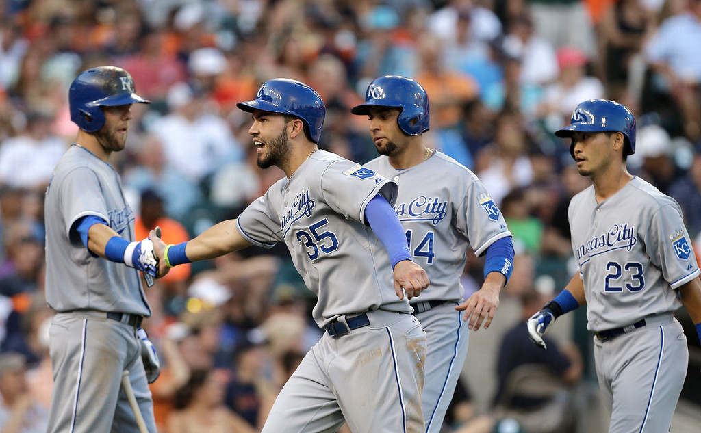 . Kansas City Royals\' Eric Hosmer (35) celebrates with Alex Gordon, left, as Omar Infante (14) and Norichika Aoki (23) look on after a Billy Butler double against the Detroit Tigers in the fifth inning of a baseball game in Detroit, Monday, June 16, 2014.  (AP Photo/Paul Sancya)