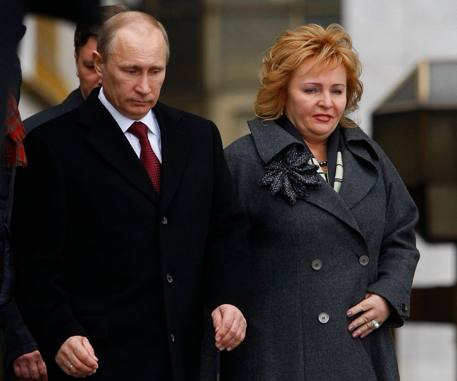 . Then Russian Prime Minister and presidential candidate Vladimir Putin and his wife Lyudmila leave a polling station in Moscow, Russia on Sunday, March 4, 2012.  Russian President Vladimir Putin and his wife Lyudmila have announced they are divorcing.  Married just a few weeks short of 30 years, the Putins announced the decision on state television after attending a ballet performance Thursday evening in the Kremlin.  ( AP Photo/Alexander Zemlianichenko, file)