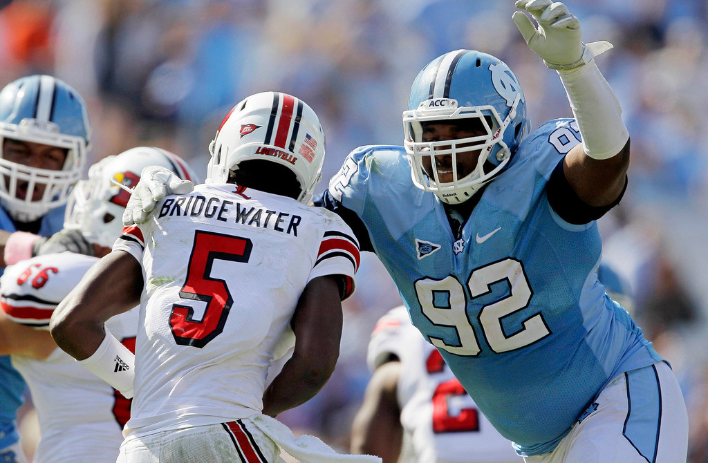 . North Carolina\'s Sylvester Williams (92) rushes Louisville quarterback Teddy Bridgewater (5) for a sack during the second half of an NCAA college football game in Chapel Hill, N.C., Saturday, Oct. 8, 2011. North Carolina won 14-7. (AP Photo/Gerry Broome)