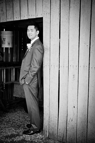 groom in front of bar