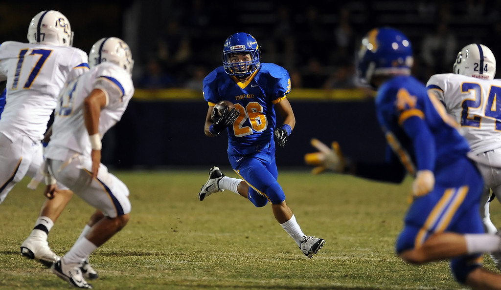. Bishop Amat\'s Gabriel Perez (26) runs for yardage against Charter Oak in the first half of a prep football game at Bishop Amat High School in La Puente, Calif. on Friday, Sept. 20, 2013.    (Photo by Keith Birmingham/Pasadena Star-News)