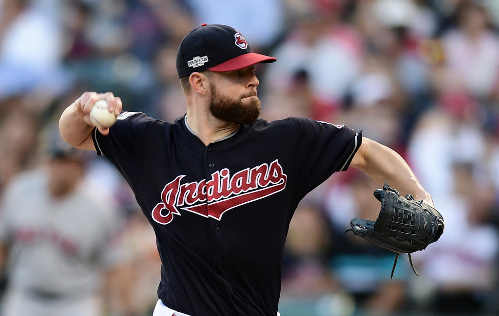 . Cleveland Indians pitcher Corey Kluber throws against the Boston Red Sox in the fourth inning during Game 2 of baseball\'s American League Division Series, Friday, Oct. 7, 2016, in Cleveland. (AP Photo/David Dermer)