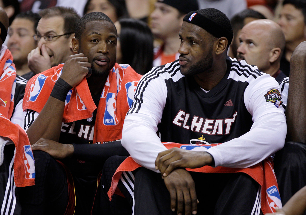 . Miami Heat\'s Dwyane Wade, left,  and LeBron James talk on the bench in the second quarter during an NBA basketball game against the Chicago Bulls in Miami, Sunday, March 6, 2011. (AP Photo/Lynne Sladky)