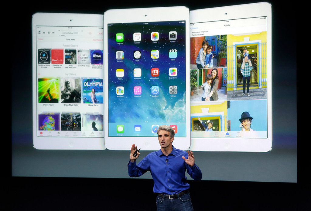 . Craig Federighi, senior vice president of Software Engineering at Apple, speaks during the new product release in Cupertino, Calif., Tuesday, Sept. 10, 2013.  (AP Photo/Marcio Jose Sanchez