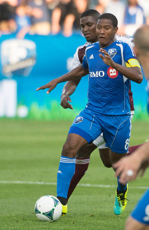 . Montreal Impact\'s Patrice Bernier brings the ball forward during the first half of an MLS soccer game against Colorado Rapids in Montreal on Saturday, June 29, 2013. (AP Photo/The Canadian Press, Peter McCabe)