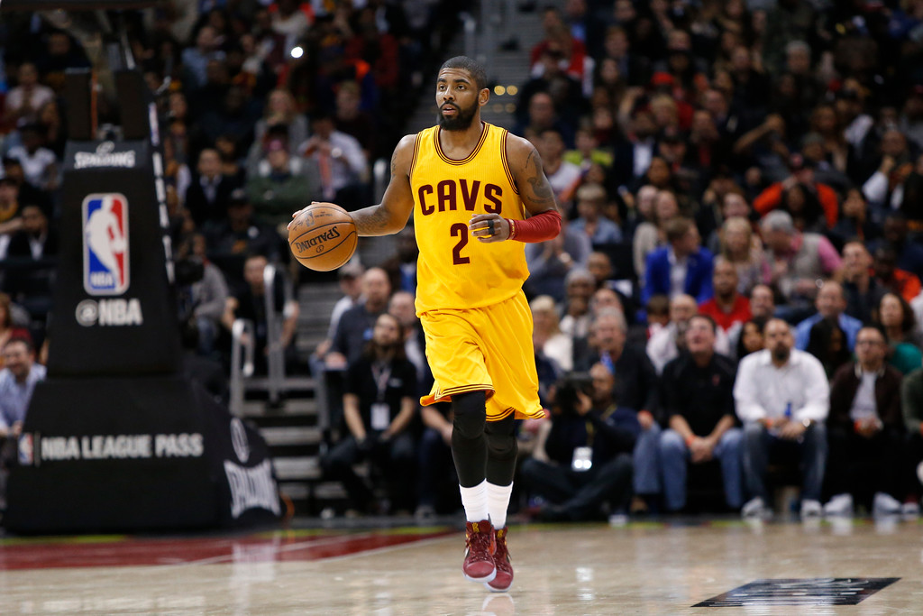 . Cleveland Cavaliers guard Kyrie Irving (2) dribbles against the Atlanta Hawks in the second half of an NBA basketball game, Friday, March 3, 2017, in Atlanta. The Cavaliers won 135-130. (AP Photo/Brett Davis)