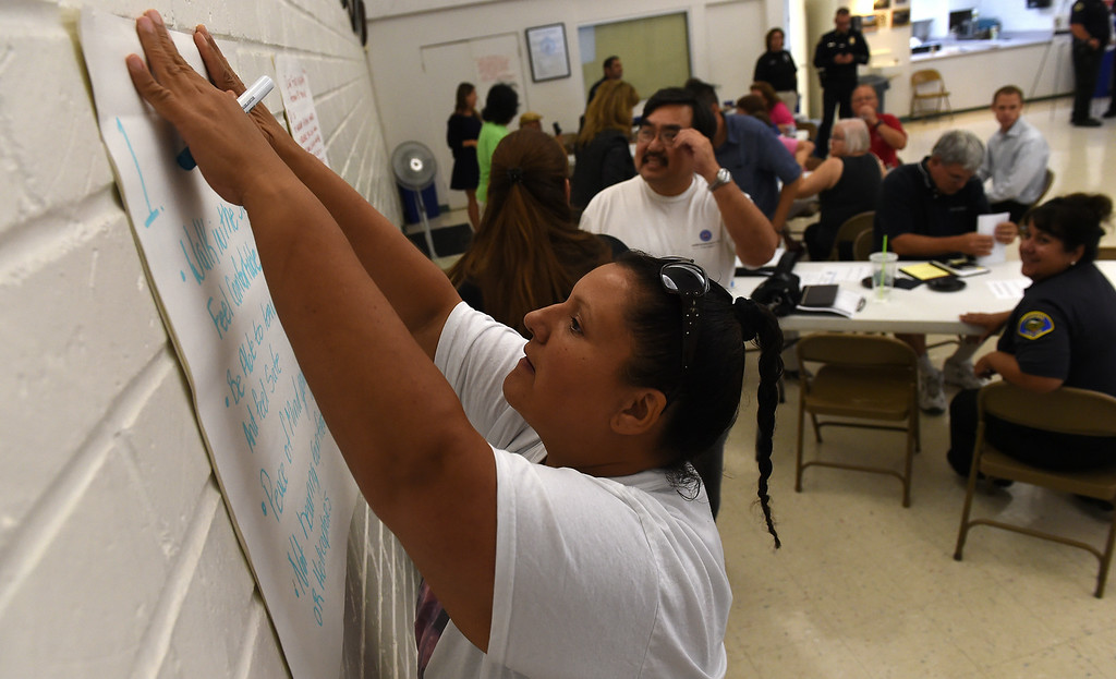 . Community members attend Pomona\'s Promise Public Safety Summit at the Ganesha Park Community Center in Pomona, CA, Wednesday, August 13, 2014. (Photo by Jennifer Cappuccio Maher/Inland Valley Daily Bulletin)