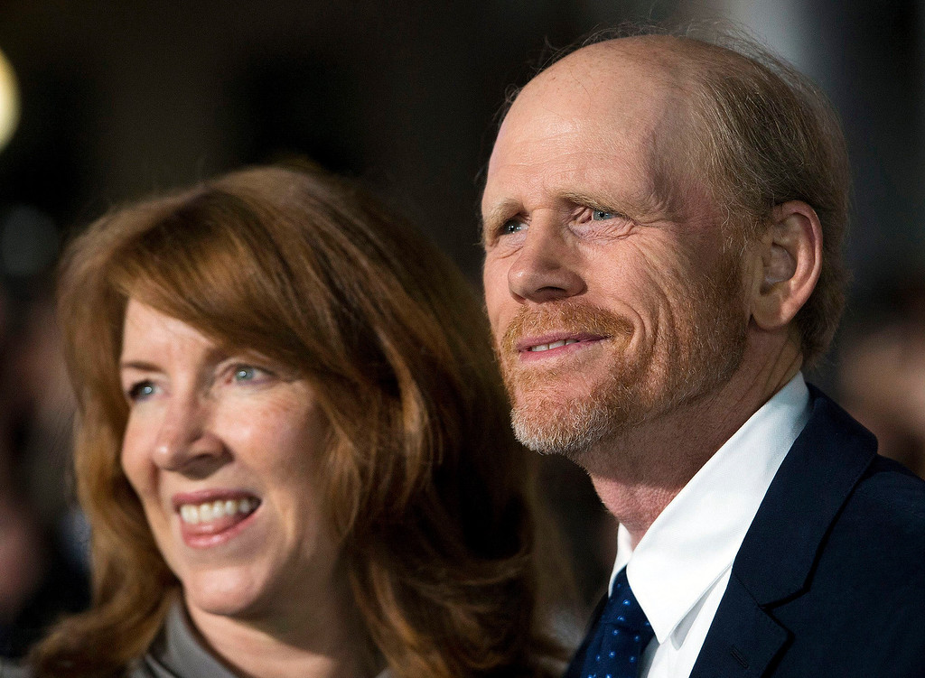 """. Director Ron Howard and his wife Cheryl Howard pose for a photographs on the red carpet at the gala for the new movie \""""Rush\"""" during the 2013 Toronto International Film Festival in Toronto on Sunday, Sept. 8, 2013. (AP Photo/The Canadian Press, Nathan Denette)"""