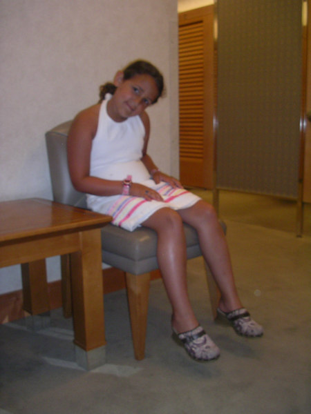 Grown up looking Char waiting at Nordstrom's.