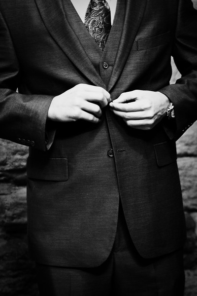 groom buttoning coat
