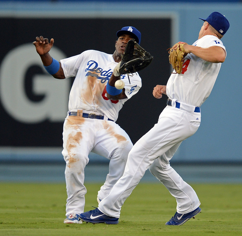 . A miscommunication between Dodgers\' Yasiel Puig #66 and Mark Ellis causes a Giants\' Brandon Belt #9 flyable drop  during their game at Dodgers Stadium Saturday, September 14, 2013. (Photo by Hans Gutknecht/Los Angeles Daily News)