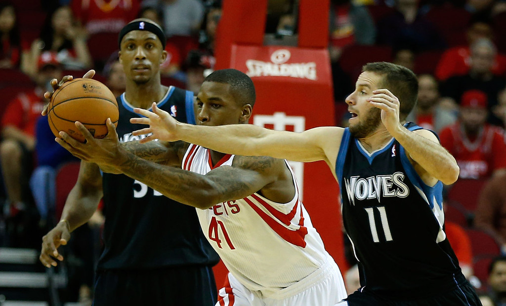 . Thomas Robinson #41 of the Houston Rockets battles for the ball with J.J. Barea #11 of the Minnesota Timberwolves.  (Photo by Scott Halleran/Getty Images)