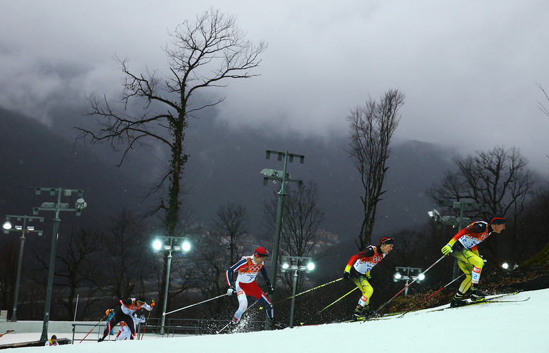 . Johannes Rydzek of Germany leads the pack in the Nordic Combined Men\'s 10km Cross Country during day 11 of the Sochi 2014 Winter Olympics at RusSki Gorki Nordic Combined Skiing Stadium on February 18, 2014 in Sochi, Russia.  (Photo by Al Bello/Getty Images)