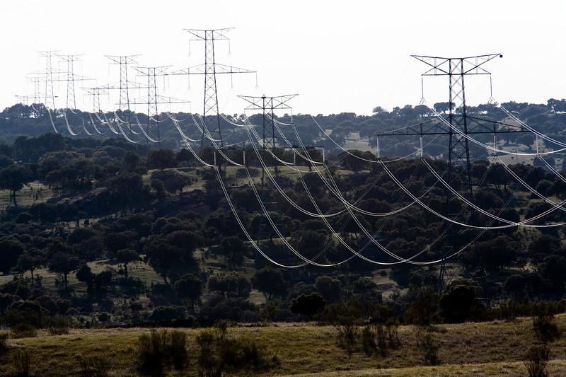High voltage power lines from Alcantara dam, province of Caceres, autonomous community of Extremadura, southwestern Spain