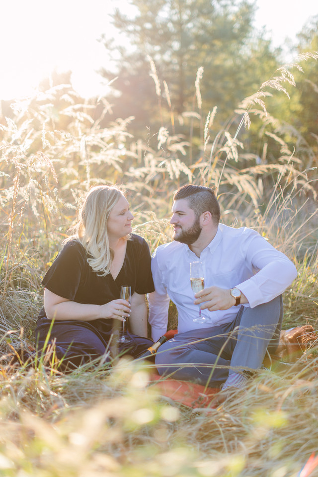 Field engagement session in Virginia with champagne.