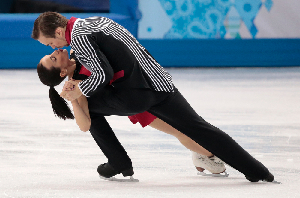 . Ksenia Stolbova and Fedor Klimov of Russia compete in the pairs free skate figure skating competition at the Iceberg Skating Palace during the 2014 Winter Olympics, Wednesday, Feb. 12, 2014, in Sochi, Russia. (AP Photo/Ivan Sekretarev)