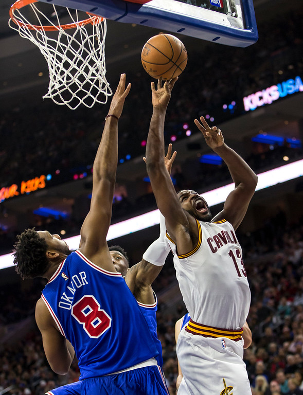 . Cleveland Cavaliers\' Tristan Thompson, right, goes up for the shot as he gets past Philadelphia 76ers\' Jahlil Okafor during the first half of an NBA basketball game, Saturday, Nov. 5, 2016, in Philadelphia. The Cavaliers won 102-101. (AP Photo/Chris Szagola)