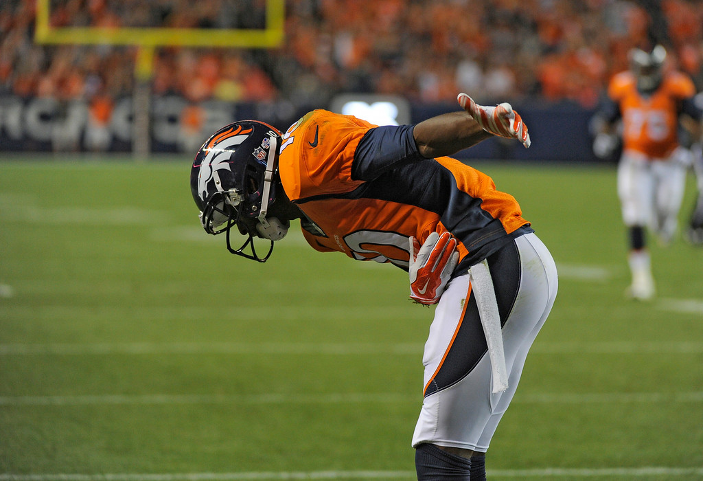 . DENVER, CO - AUGUST 23: Denver Broncos wide receiver Emmanuel Sanders (10) takes a bow after his  touchdown catch against the Houston Texans during the second quarter August 23, 2014 at Sports Authority Field at Mile High Stadium. (Photo by John Leyba/The Denver Post)