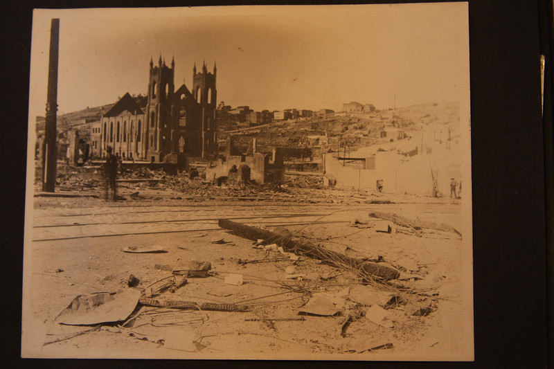 Washington Square & Church in San Francisco 4/18/1906 after the earthquake and fire Looking across Columbus St.  Coit Tower hill is on the right.