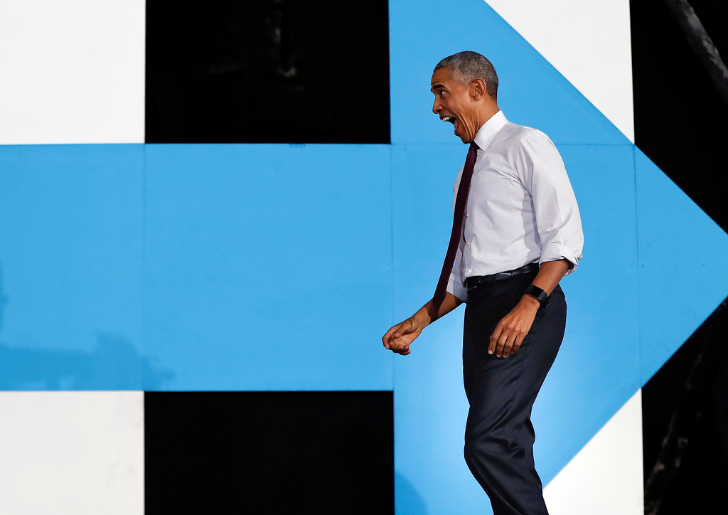 . President Barack Obama reacts to seeing supporters as he walks on stage at PNC Music Pavilion in Charlotte, N.C., Friday, Nov. 4, 2016 during a campaign rally for Democratic presidential candidate Hillary Clinton. (AP Photo/Pablo Martinez Monsivais)