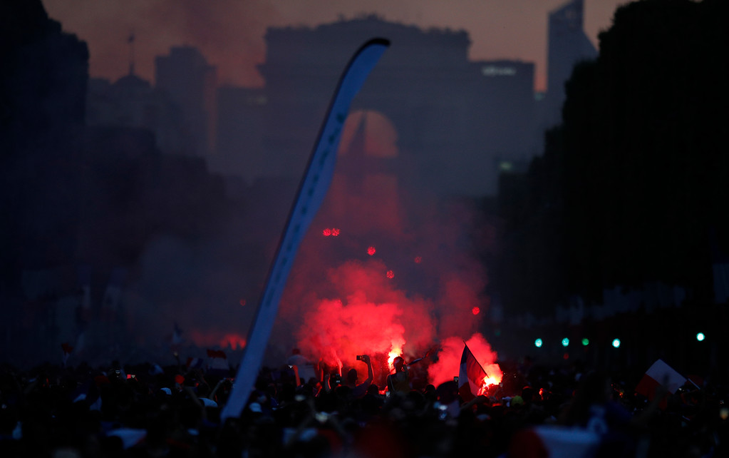 . The crowd celebrates the Champs Elysees avenue, with the Arc de Triomphe in background, after France won the soccer World Cup final match between France and Croatia, Sunday, July 15, 2018 in Paris. France won its second World Cup title by beating Croatia 4-2 . (AP Photo/Francois Mori)