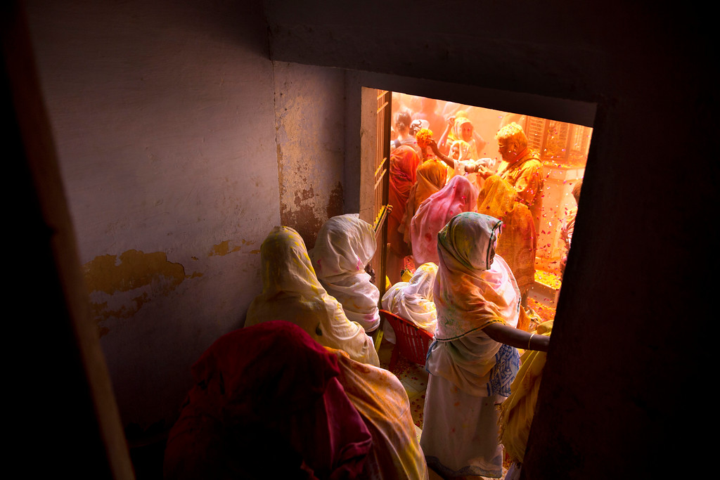 . Widows, who were once forbidden to participate, throw flower petals and colored powder during the religious arrival of spring festival called Holi at the Gopinath temple in Vrindavan, 180 kilometers (112 miles) south-east of New Delhi, India, Thursday, March 9, 2017. Up to just a few years ago the festival was forbidden for Hindu widows. Like hundreds of thousands of observant Hindu women, they would have been expected to live out their days in quiet worship, dressed only in white, with their very presence being considered inauspicious for all religious festivities. (AP Photo /Manish Swarup)
