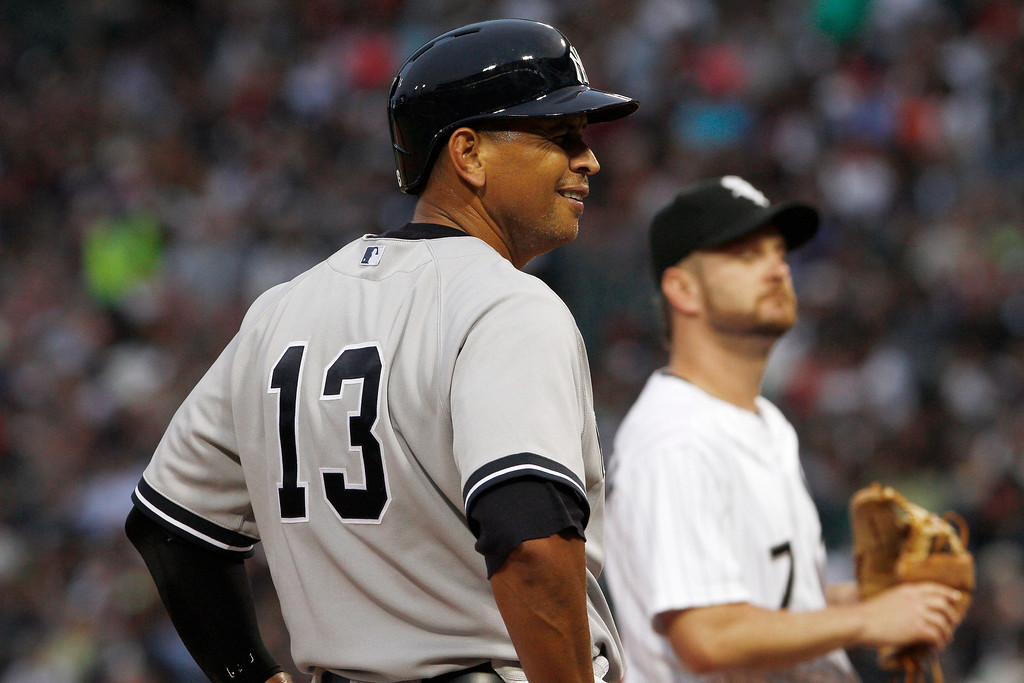 . New York Yankees\' Alex Rodriguez (13) smiles as he stands on third base during the first inning of a baseball game against the Chicago White Sox at US Cellular Field in Chicago on Monday, Aug., 5, 2013. (AP Photo/Charles Cherney)