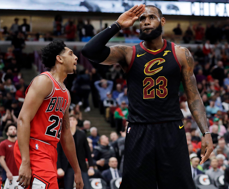 . Cleveland Cavaliers forward LeBron James, right, reacts after blocking a shot by Chicago Bulls guard Cameron Payne during the second half of an NBA basketball game Saturday, March 17, 2018, in Chicago. The Cavaliers won114-109. (AP Photo/Nam Y. Huh)