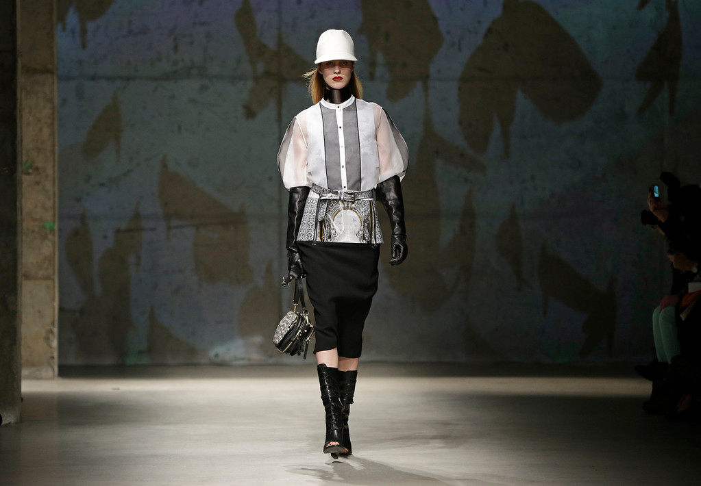 . A model walks the runway during the presentation of the Kenneth Cole Fall 2013 fashion collection during Fashion Week in New York, Thursday, Feb. 7, 2013.  (AP Photo/Kathy Willens)