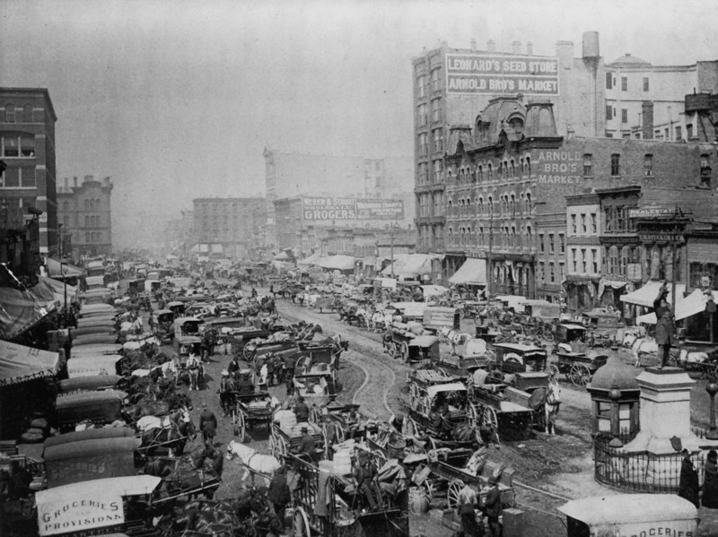 Title: Haymarket Square Date Created/Published: [c1893]  Summary: Print shows Haymarket Square, Chicago, view from monument, looking up the street jammed with commercial wagons.   http://www.loc.gov/pictures/item/2004669967/