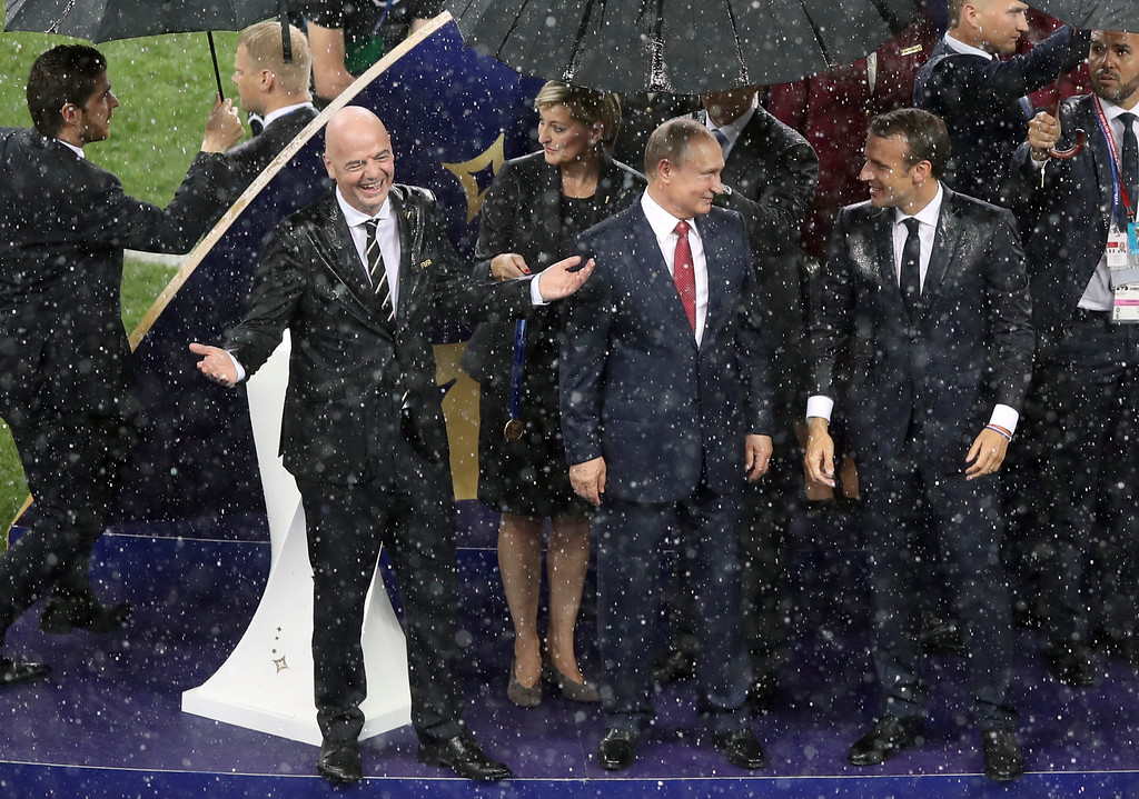 . FIFA President Gianni Infantino, left, gestures while Russian President Vladimir Putin and French President Emmanuel Macron, right, look at each other at the end of the final match between France and Croatia at the 2018 soccer World Cup in the Luzhniki Stadium in Moscow, Russia, Sunday, July 15, 2018. (AP Photo/Thanassis Stavrakis)