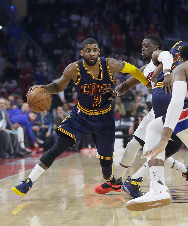 . Cleveland Cavaliers guard Kyrie Irving (2) drives on Detroit Pistons guard Reggie Jackson during the first half in Game 4 of a first-round NBA basketball playoff series, Sunday, April 24, 2016 in Auburn Hills, Mich. (AP Photo/Carlos Osorio)