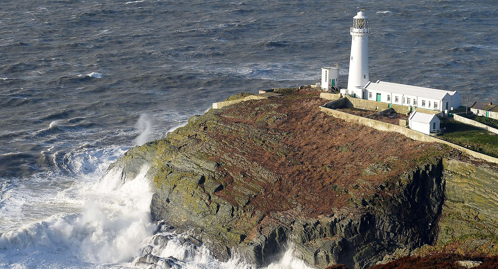 . Strong winds cause the waves to hit the rocks below the lighthouse at South Stack on the Island of Anglesey in Wales on January 7, 2014. AFP PHOTO / PAUL ELLISPAUL ELLIS/AFP/Getty Images