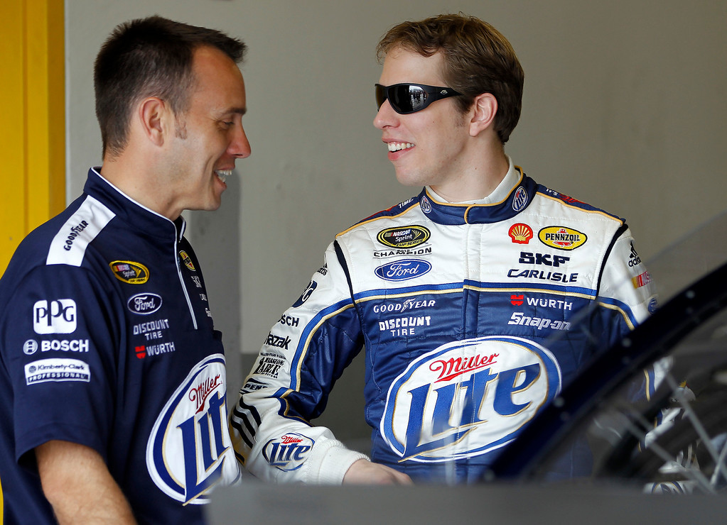 . Brad Keselowski, right, talks to crew chief Paul Wolfe in the garage during practice for the Daytona 500 NASCAR Sprint Cup Series auto race Wednesday, Feb. 20, 2013, in Daytona Beach, Fla. (AP Photo/Terry Renna)