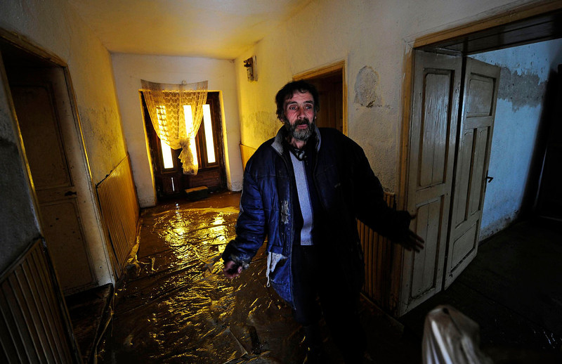 . A man gestures as he wades through floodwater in his house in Murtino, 180 km east of Skopje February 27, 2013. One man drowned and several hundred homes in Macedonia were flooded on Tuesday as two days of heavy rain drenched farmland and caused power outages in the Balkan country, authorities said. REUTERS/Ognen Teofilovski